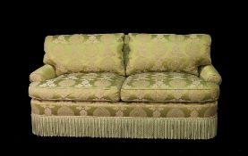 'Lewis Mittman Inc', a modern two seater sofa with green foliate upholstery and rollover arms,