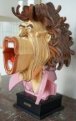 B Marty; Mick Jagger, a painted laminated wood three dimensional caricature bust, signed, 66cm high.
