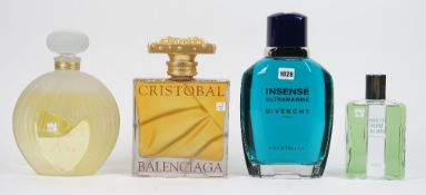 Four over sized perfume bottles for advertising purposes, comprising; Givenchy 'Insense', 'Nina',