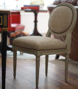 A pair of Louis XVI style grey painted oval back silver upholstered side chairs,