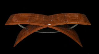 A 20th century hardwood 'X' frame footstool with chrome stretcher support, 118cm wide x 39cm high.