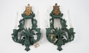 A pair of Regency style green painted and ormolu mounted two branch wall appliques,
