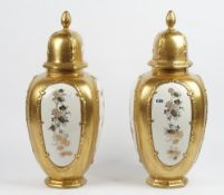 A pair of modern Italian porcelain vases and covers,