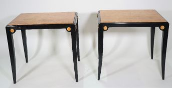 A pair of modern ebonised and polychrome painted side tables, 72cm wide x 70cm high, (2).