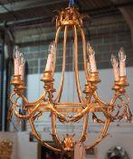 A patinated metal six light chandelier, 70cm diameter.