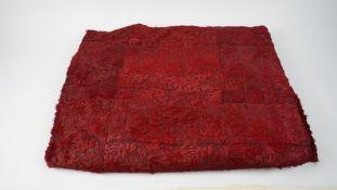 A dark red faux fur throw with pierced foliate pattern, approx. 254cm x330cm.