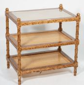 A modern three tier what-not with painted wood grain decoration, 66cm wide x 72cm high.