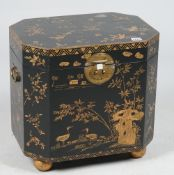 A chinoiserie lacquer octagonal box with hinged lid, 45cm wide.
