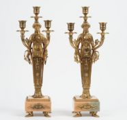 A pair of Victorian style gilt metal and marble three branch figural candelabra,