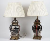 A pair of modern Chinese style pottery lamps,