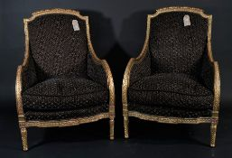 A pair of Louis XV style giltwood bergere armchairs, with brown/ black honeycomb pattern upholstery,