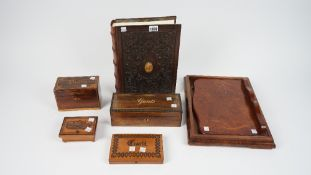 A modern wooden bound photograph album in the form of a leather bound book, 32.