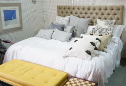 A modern upholstered large double bed with headboard, mattress and divan, the headboard 207cm wide.