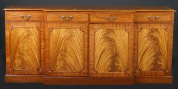 Martin J Dodge; a George III style mahogany breakfront bookcase,