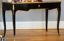 A Louis XVI style ormolu mounted, black lacquer bureau plat, with single drawer,