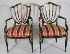 A pair of Regency style polychrome painted, shield back open armchairs, 57cm wide x 96cm high, (2).