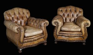 A pair of Victorian style brown button back mahogany framed Chesterfield armchairs on ball and claw
