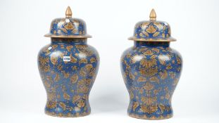 A pair of modern pottery vases and covers,