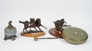 A modern equestrian bronze group on an oval plinth, 28.