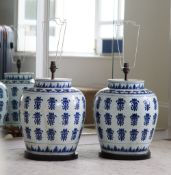 A pair of South East Asian modern blue and white baluster lamps, 47cm high.