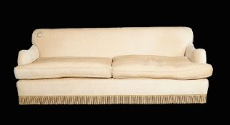 A pair of modern three seater sofas with beige upholstery on hardwood turned supports,