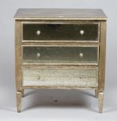 A pair of modern silver painted chests with three mirrored drawers and mirrored sides,