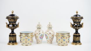 A pair of modern porcelain and gilt metal mounted vases and covers, each of twin handled urn form,