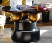 A modern design ebonised centre table, on circular plinth base, 100cm diameter x 72cm high.