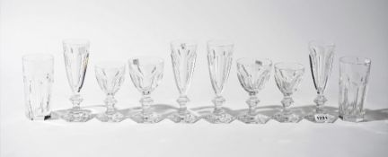 A part suite of Baccarat crystal stemware, comprising; twenty champagne flutes, 18cm high,