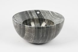 A modern marble bowl, with a wide border and circular recess, 38cm diameter.