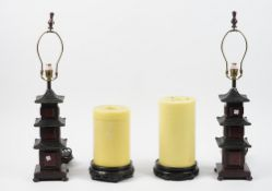 A pair of modern table lamps formed as pagodas, 68cm high, and a pair of vase stands, (4).
