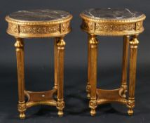 A pair of Regency style giltwood marble topped occasional tables, on fluted tapering supports,