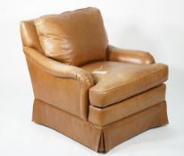 Edward Ferrel; a modern Howard style leather upholstered low armchair, 80cm wide x 80cm.