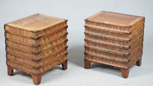 A pair of modern walnut lift top trunks formed as a stack of books, 46cm wide x 51cm high.