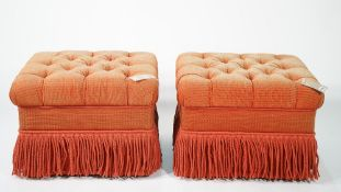Lewis Mittman; a pair of modern rectangular red upholstered and tasselled footstools,