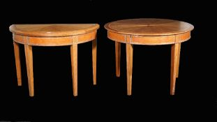 Linley, a pair of modern demi-lune foldover tables on tapering square supports,