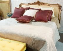 A Victorian style white painted and parcel gilt decorated kingsize bed with divan base and mattress,