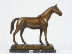 A modern composite bronze stallion, modelled on a naturalistic base and marble rectangular plinth,