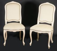 A pair of Louis XV style cream painted and beige upholstered side chairs, 52cm wide x 104cm high,