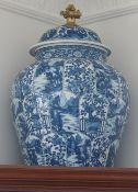 A pair of Chinese blue and white baluster vases and covers with gilt finial, modern, each 55cm high,
