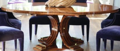 A modern oval coromandel dining table, 233cm wide x 77cm high.