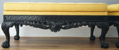 A pair of yellow upholstered black painted composite stools, each on claw and ball feet,