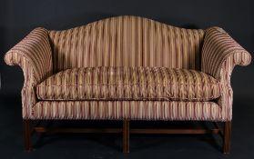 A George III style mahogany framed arch back sofa,