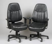 A pair of modern office adjustable armchairs, 69cm wide x 120cm high, (2).