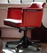 A pair of modern red leather upholstered desk chairs, 62cm wide x 83cm high.