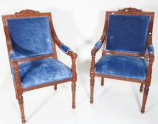 A pair of George III style mahogany blue upholstered open armchairs,