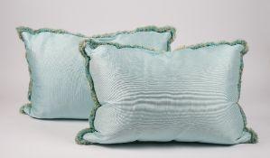 Two silk aqua tasselled cushions,