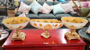 A group of three 20th century amber flashed glass and gilt metal pedestal bowls,