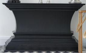 A modern ebonised console table, on tapering plinth base, 150cm wide x 80cm high.