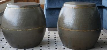 A pair of parcel gilt patinated metal barrel seats, 38cm wide x 45cm high, (2).